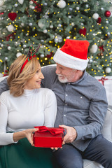 Positive delighted woman looking at her husband
