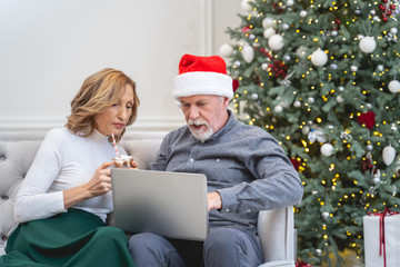 Serious loving couple communicating with relatives online
