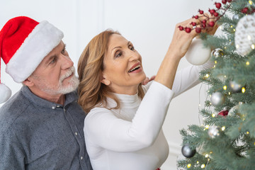Close up of cheerful people standing near tree
