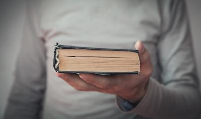 Caucasian man holding bible. Religion Fotomurales