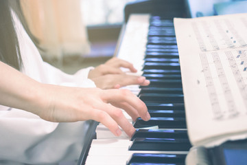 Teacher teaching little girl to play on piano. Concept of music study and creative hobby, Family are Image - Piano Keyboard and hands of child and adult playing music