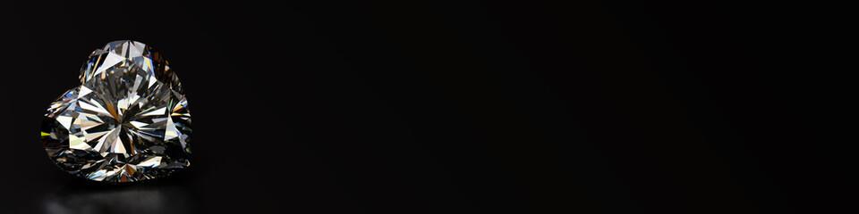 Heart cut diamond on black background, wide image.