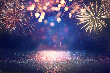 abstract gold, black and blue glitter background with fireworks. christmas eve, 4th of july holiday concept Fotobehang
