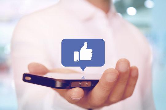 スマートフォンで親指 いいねのマーク SNS like, thumb up on smartphone SNS app