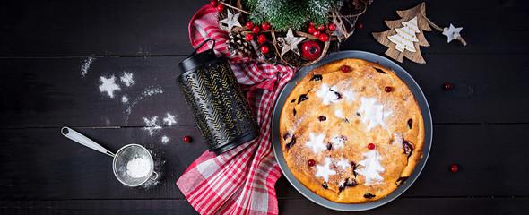 Christmas fruit cake, pudding on dark table. Top view, overhead, banner