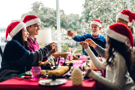 Portrait of happy big family celebrating santa hats having fun and lunch together enjoying spending time together in christmas time at home