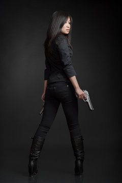 Young woman with pistols
