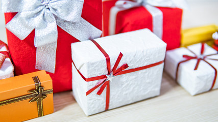 Christmas present concept. Group of colorful gift box with ribbon on wooden table. Giving and greeting for Xmas and New Year holiday. Xmas Ornament for Festive season and celebration.