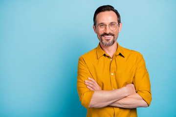 Portrait of charming mature man true boss feel content emotions wear yellow shirt isolated over...