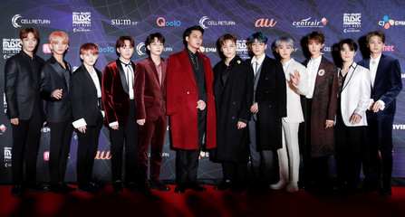 Members of South Korean boy band SEVENTEEN pose on the red carpet during the annual MAMA Awards at Nagoya Dome in Nagoya