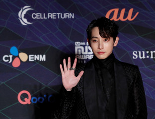 South Korean actor Lee Soo-hyuk poses on the red carpet during the annual MAMA Awards at Nagoya Dome in Nagoya