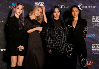 Members of South Korean girl group MAMAMOO pose on the red carpet during the annual MAMA Awards at Nagoya Dome in Nagoya
