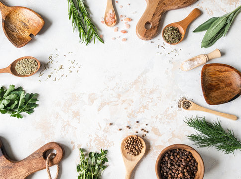 Fresh raw Herbs, various spices and wood kitchen were frame on textured background. top view,