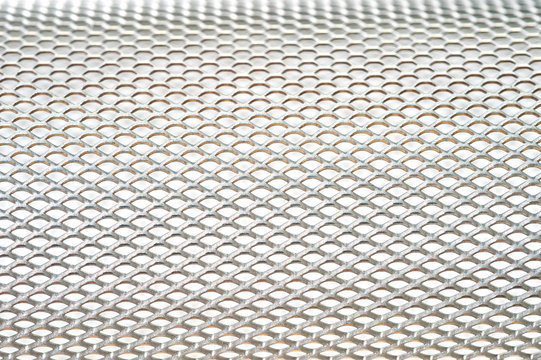 Close-up metal mesh structure with equal intervals of holes