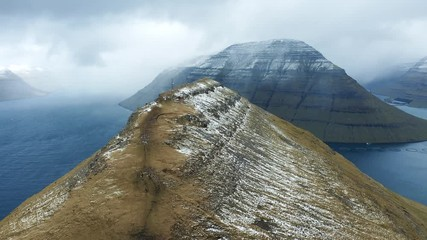 Wall Mural - Flying towards the island of Kalsoy over the Klakkur mountain on Faroe Islands
