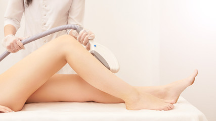 Laser elos medical device. Remove unwanted hair and asteriks. Cosmetology spa procedure at salon. Doctor laser leg depilation. Perfect treatment