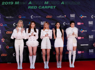 Members of South Korean girl band ITZY pose on the red carpet during the annual MAMA Awards at Nagoya Dome in Nagoya