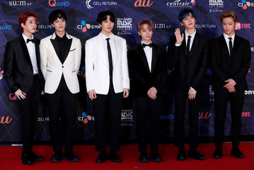 Members of South Korean boy band ONEUS pose on the red carpet during the annual MAMA Awards at Nagoya Dome in Nagoya,