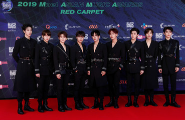 Members of Chinese boy band Unine pose on the red carpet during the annual MAMA Awards at Nagoya Dome in Nagoya