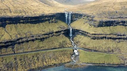 Wall Mural - Flying towards the Fossa Waterfall on island Bordoy in the Faroe Islands