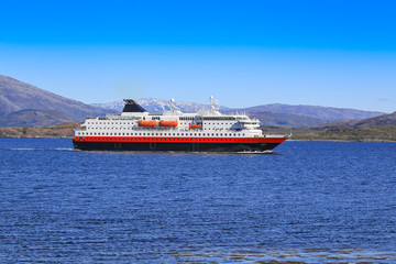 Coastal passenger ships arrives at Brønnøysund harbor, Nordland county