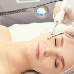 Dermatology skin care facial therapy. Medical spa anto wrinkles procedure. Woman face rejuvenation. Pretty girl. Rf cosmetician equipment