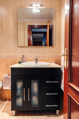 Interior of bathroom with washbasin cabinet and mirror