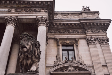 lion statue and building of Brussels Stock Exchange Belgium.