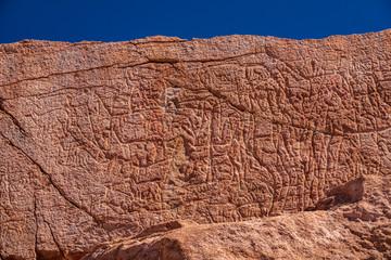 Petroglyphs at Yerbas buenas rocks in Atacama desert