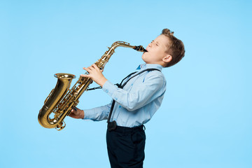 boy with saxophone Fotobehang