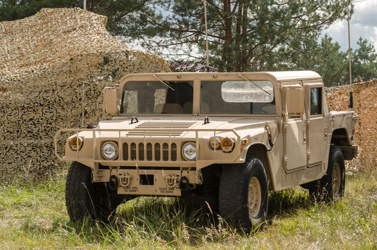 BORNE SULINOWO, WEST POMERANIAN / POLAND - 2019: High Mobility Multipurpose Wheeled Vehicle - A military vehicle in a desert camouflage at an improvised checkpoint