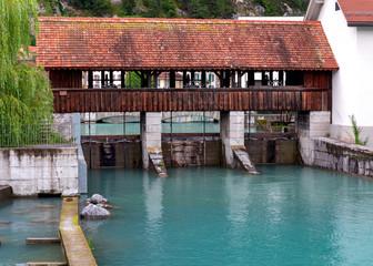 Interlaken. Old wooden dam on the mountain river Aare.