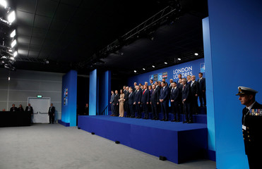 NATO Alliance leaders pose for a family photo during the annual NATO heads of government summit at the Grove Hotel in Watford