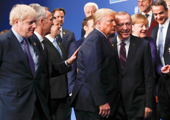 NATO Alliance leaders leave the stage after family photo during the annual NATO heads of government summit at the Grove Hotel in Watford