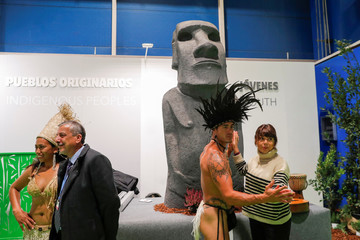 Visitors pose for a picture at the Indigenous People space during the U.N. climate change conference (COP25) in Madrid