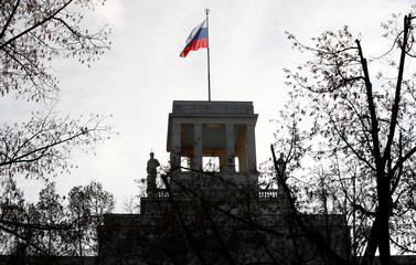 The national flag flutters on top of the Russian embassy after Germany expelled two Russian diplomats in Berlin