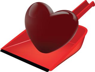 cuore rosso su una paletta per raccogliere sporco