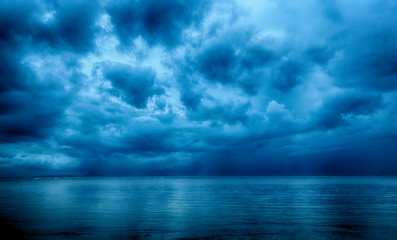 Photo sur cadre textile Bleu jean Dramatic stormy dark cloudy sky over sea, natural photo background
