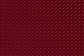 burgundy leather background with imitation weave texture. Glossy dermantine, artificial leather structure. Fake woven leather wicker textured surface.