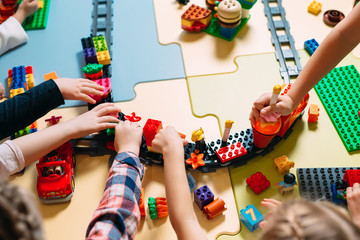 Educational toys for preschool and kindergarten child. Child playing with constructor blocks at...