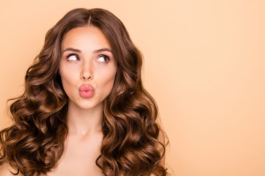 Close-up portrait of her she nice-looking attractive sweet gorgeous girlish curious wavy-haired girl looking aside sending kiss pout lips copy space isolated over beige pastel color background