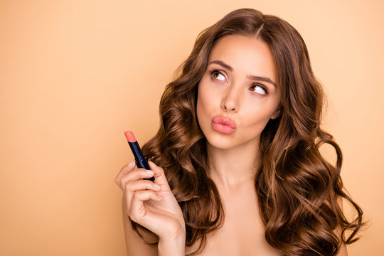 Close up photo of charming girl hold pomade try check new lips stick matte effect isolated over pastel color background