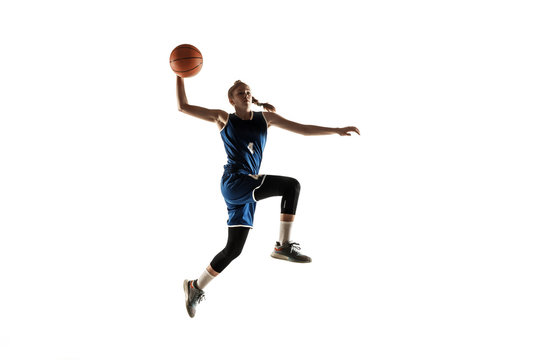 Young caucasian female basketball player of team in action, motion in jump isolated on white background. Concept of sport, movement, energy and dynamic, healthy lifestyle. Training, practicing.