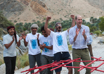 Britain's Prince William reacts while interacting with youth members of Outward Bound Oman during a visit to Wadi al Arbeieen