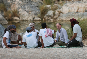 Britain's Prince William speaks with youth members of Outward Bound Oman during a visit to Wadi al Arbeieen