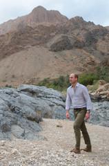 Britain's Prince William walks during a visit to Wadi al Arbeieen