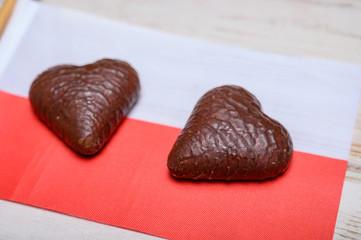 Tasty gingerbread glazed cookies from Torun, Poland and flag of Poland
