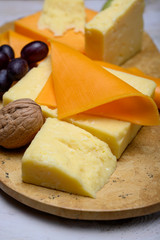 Cheese collection, blocks and slices of yellow and matured english cheddar cheese