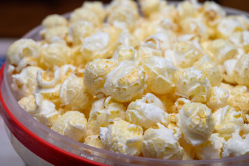 Plastic bucket with sweet popcorn ready to eat