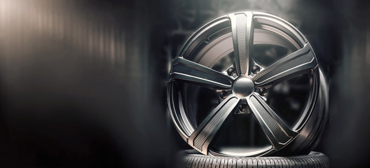 beautiful black alloy wheels made of aluminum on a dark background. exclusive wheels for expensive cars. Close up, copyspace Fototapete